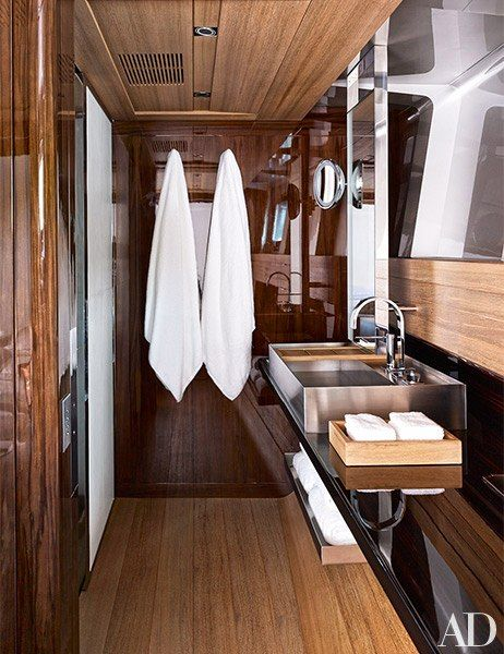 Bathrooms. Seahawk, 197' sailing yacht. Teak floors and ceiling, ebony counter, rosewood accents.  AD January 2015.  Designer: Guillaume Rolland.