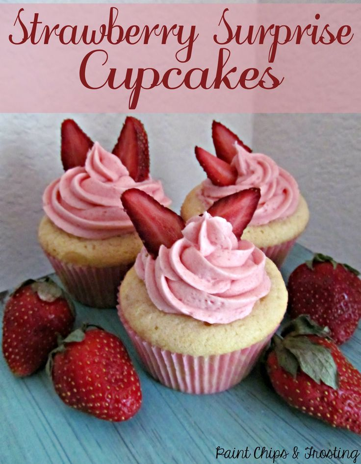 Strawberry Surprise Cupcakes: Vanilla buttermilk cupcakes with a strawberry baked inside and topped with fresh strawberry buttercream!
