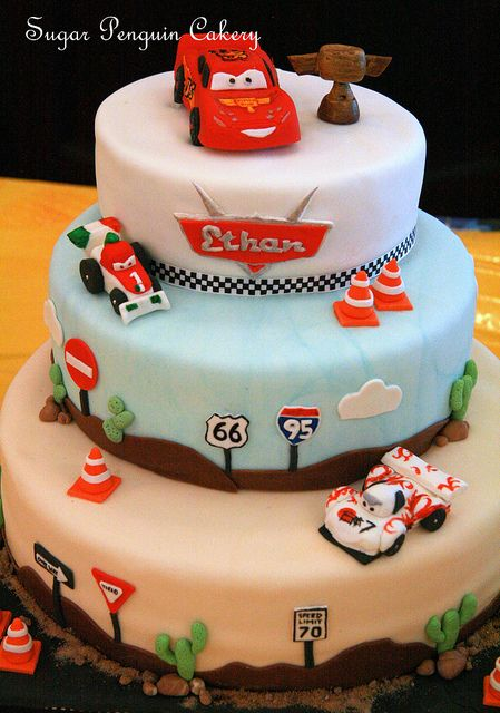 Lightning McQueen cake by sugarpenguin, via Flickr - Love teh orange cones and street signs!