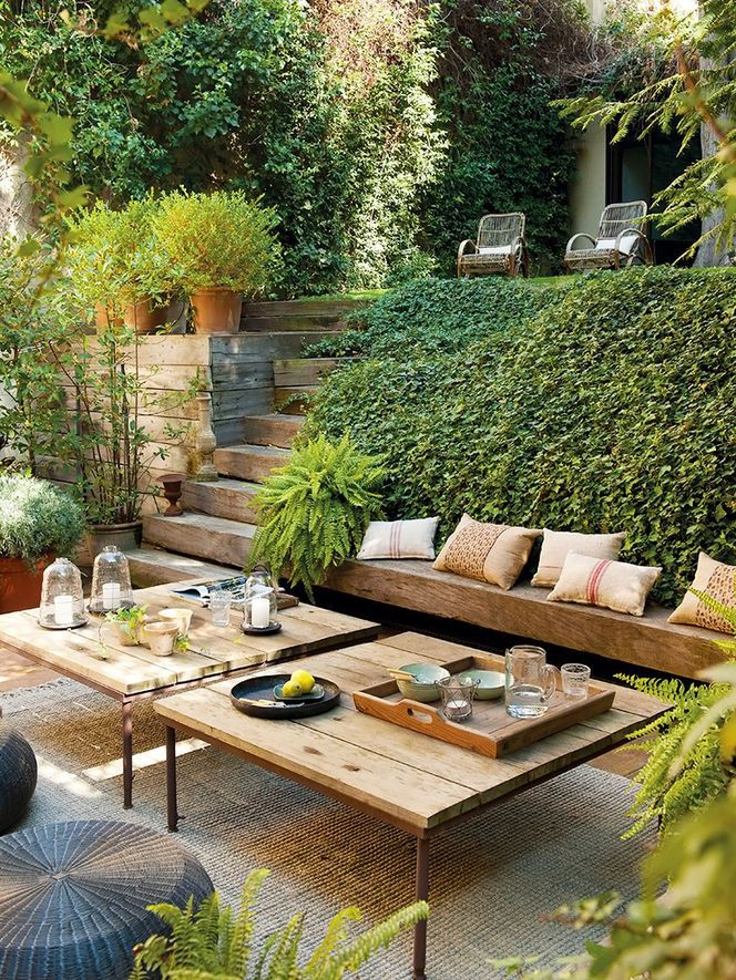 Love the idea of creating wooden wall around base of deck, mounding soil and adding lower bench like this one.
