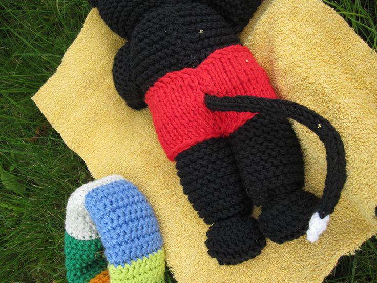 knitted cat in swimsuit sunbathing