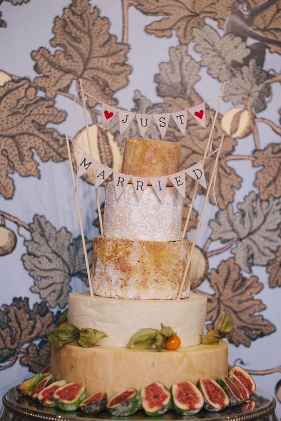 A tower of cheeses and figs is always a great alternative to a wedding cake