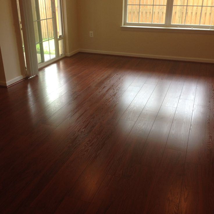 Empire Hardwood Floors introducing new homestead and residence wood laminate flooring from empiretoday My Estate Living Auburn Cherry 8mm 7 Inch Plank Laminate Wood Flooring Installed By Empire Today With 30 Year Stain Fade Topical Moisture A