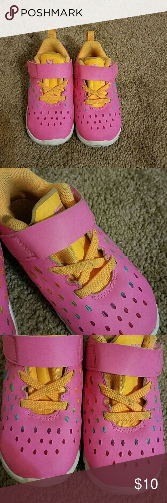 Nike Free Pink Sneakers Toddler Size 7 Adorable Nike Free Pink Sneakers with Colors of Orange, Blue, & Turquoise. Great condition as far as wear but as shown in pics they are dirty. Velcro closure for easy on and off Nike Shoes Sneakers