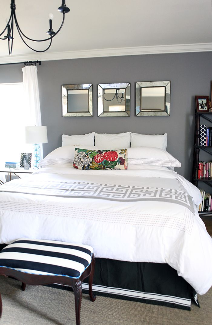 Great splash of color in the pillow- maybe a little larger? Also, I would prefer a demask print instead of striped on the bench at the foot of the bed?