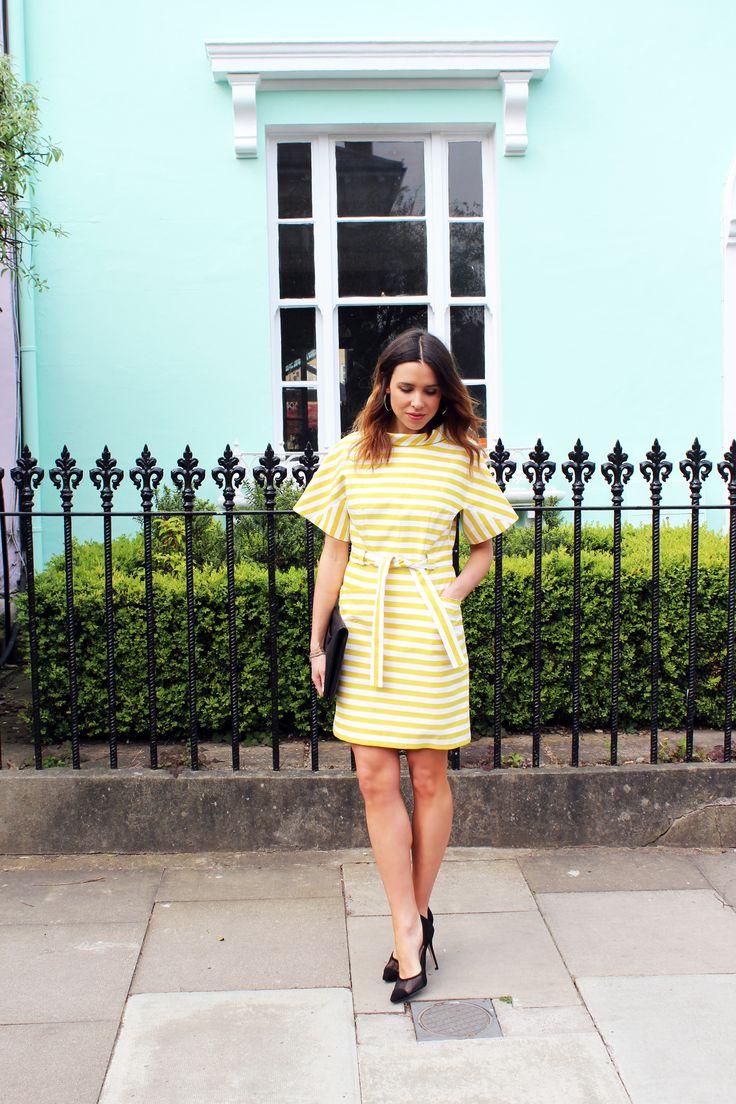 @annelibush of fashion blog What I Bought Today of fashion blog What I Bought Today wearing our stripe atelier Kimono dress.