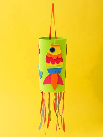 <p>Create this lovely ocean-inspired windsock with colorful ribbon and a few sheets of crafts foam.</p> <p><b>Make It:</b> Start with a large sheet of crafts foam for your windsock base; play with cut pieces of colorful crafts foam to create fish patterns to decorate it. Glue the fish shapes to the large sheet. Roll the large sheet and staple the ends together. Attach ribbons in various colors and lengths at the bottom, and add one ribbon at the top to hang the windsock.</p>
