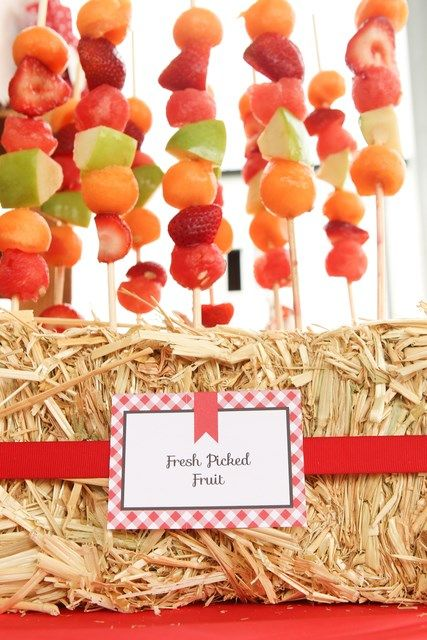 Fruit Kabobs in a hay bale at a Cowgirl's Farm Party www.weheartparties.com