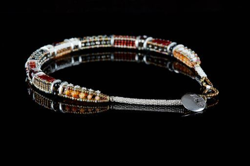Choker with Agate, Cornelian, Garnet, Murano Glass, Pyrite, Tourmaline and signature silver fastening (#1448).