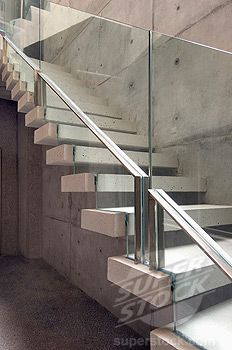 Stock Photo #4053-5440, Concrete floating stairs with glass railing