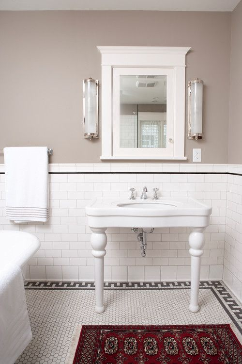 Hex floor with rug border, white subway tile with black accent