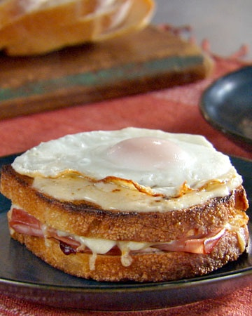 Croque Madame: The croque monsieur -- a grilled ham and Gruyere sandwich topped with rich cheese sauce -- becomes a croque madame when you add a fried egg.