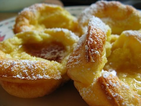 dutch baby or german baked pancake done in a muffin tin.