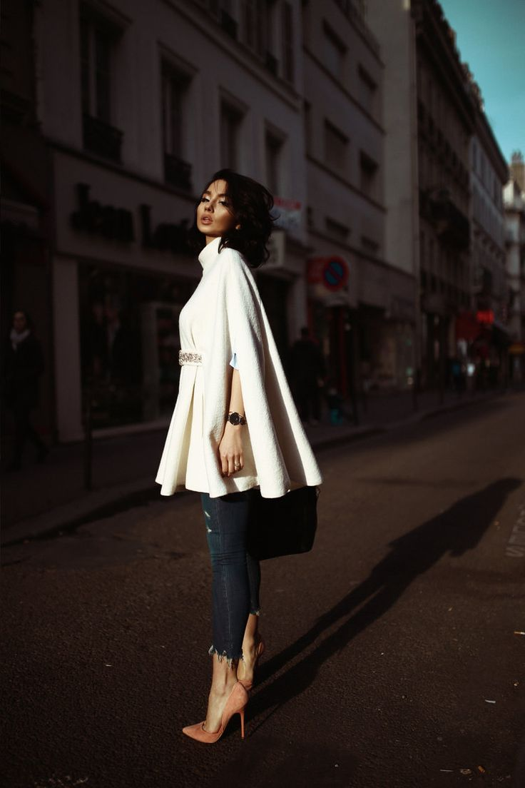 Paris street style. Editorial by Vlad Petrut. A pure white cape is on sale.