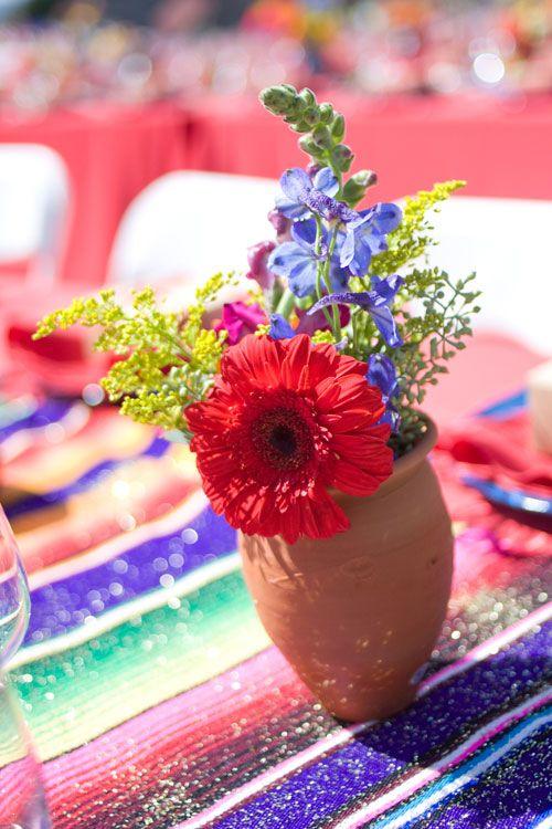 multicolored-centerpiece-in-clay-vase-mexican-fiesta-tablecloth