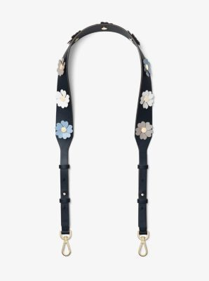 Accented with feminine floral appliqués, this guitar-strap-inspired leather shoulder strap lends bohemian charm to modern ensembles. Clip it onto your handbag for a fresh, tactile update.