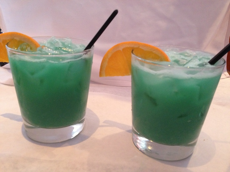 Delicious drinks made of orange juice pineapple blue for Orange and blue cocktails