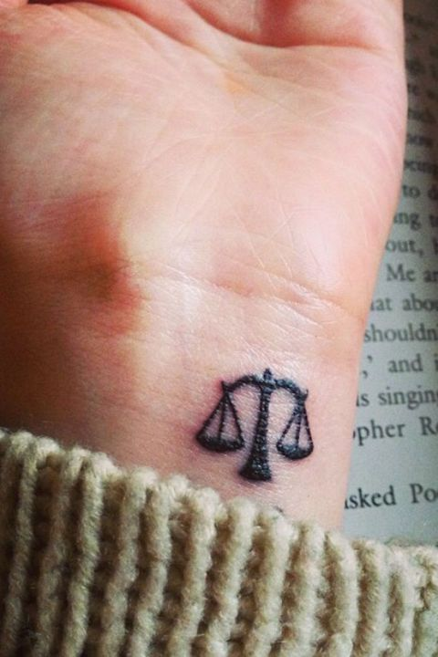 36 Astrology Tattoos That Are Out of This World: LIBRA: Apparently, Libras like wrist tattoos, and we don't blame them.