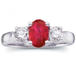 This ring is fine jewelry. This genuine oval shaped quality ruby is the center gem for two very good round diamonds, all set in platinum. This is a great classic combination and design.