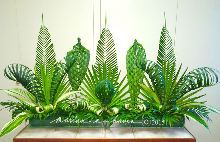 My altar centerpiece for Palm Sunday 2015, at St. Dunstan Catholic Church, Millbrae. One can make a good foliage arrangement like this just by using variances in color, texture, height, pattern, & design. ;-)