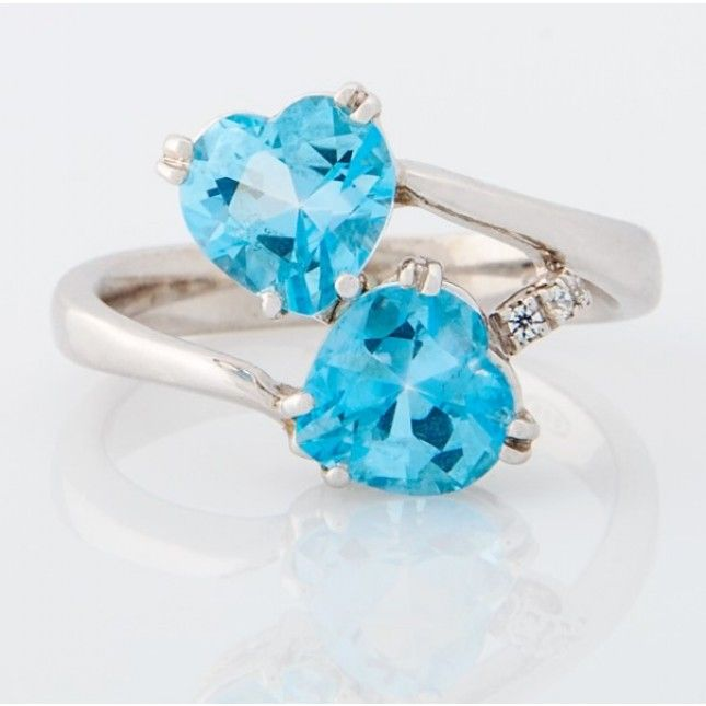 Double heart blue topaz and diamond ring in white gold