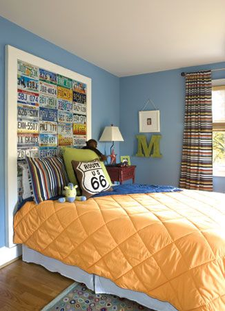 Cute headboard wall idea for boys...could gather plates from all the places they have been...could I get one from South Korea?
