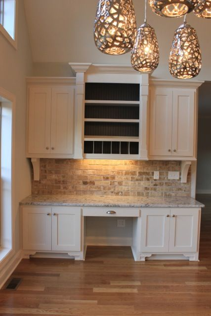 love the flooring; center cabinet to ceiling; decorative braces underneath