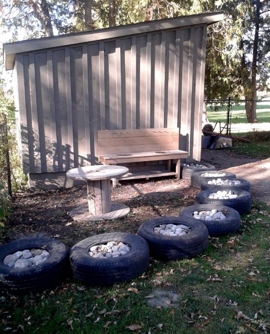 North Grenville Cooperative Preschool and Learning Centre- Tires offer a creative solution to outdoor loose part storage for things like rocks and stones.