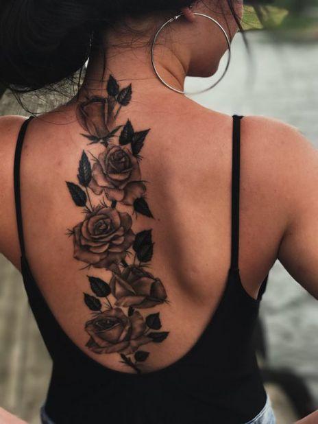 Flower spine back tattoo