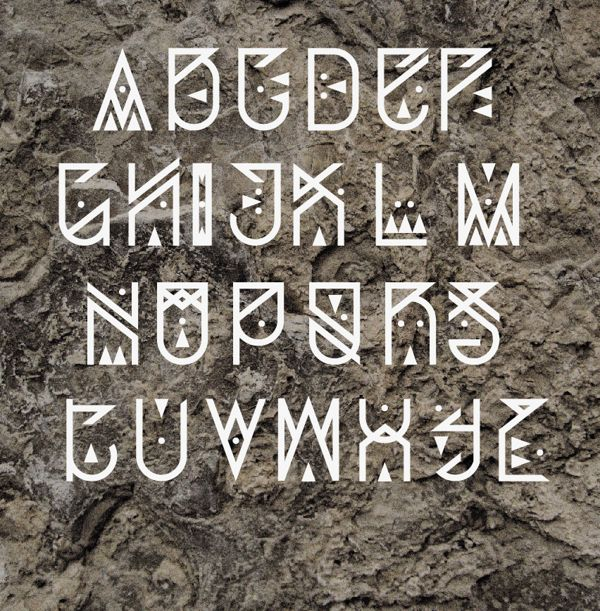 Obsessed with this typeface! I love the tribal look it has as well as the white on the grey background. Depending on the letters that are needed this could be really cool as long as it was readable. Maybe changing a few things to make it so it can be read. This would also look great with colors.