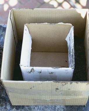 Make a Hypertufa Trough | Fine Gardeningo make a rectangular planter, I use two nesting cardboard cartons as molds. The larger box functions as the outside form and the smaller box is placed inside. This creates a space of 1 in. to 2 in. between the two boxes into which the mixture can be packed and tamped down. A larger trough will require thicker walls to maintain strength and, therefore, more space between the two boxes.