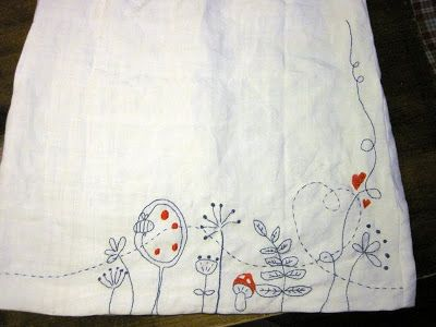 Grasflecken. grey and red embroidered dish towel