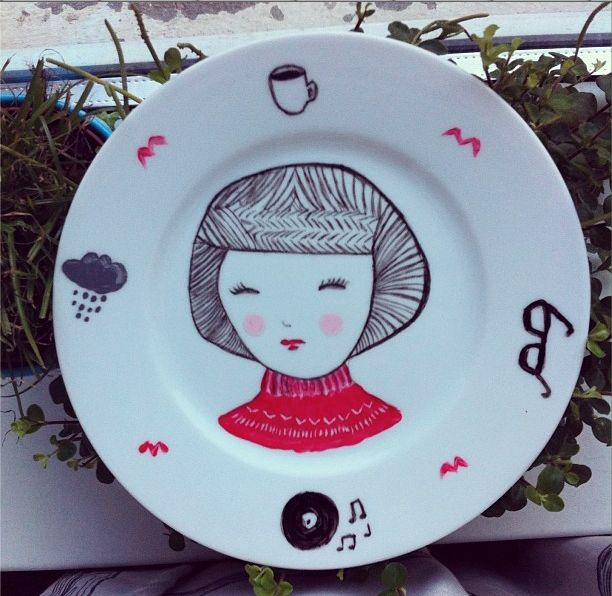 one of the first plates i painted. it's a swedish hipster, although it kind of looks like stewie from family guy.