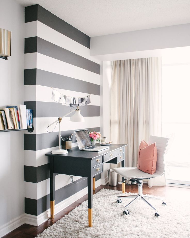 We originally toyed with the idea of wallpapering the bump-out in the wall to define the space, but ended up painting bold charcoal stripes. Not only is it one of the first things people notice, but it was definitely the more cost-effective option, and its impermanence made our landlord a lot less wary.