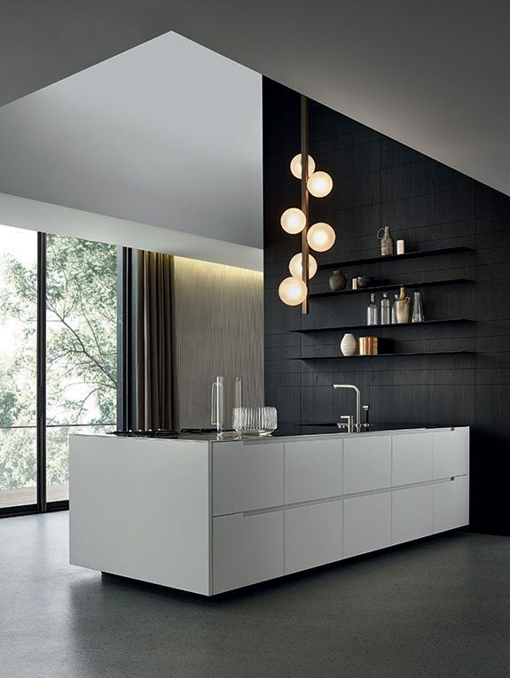 black and white contemporary kitchen - love the black wall and warm pendant lighting