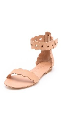 Scalloped leather sandals.