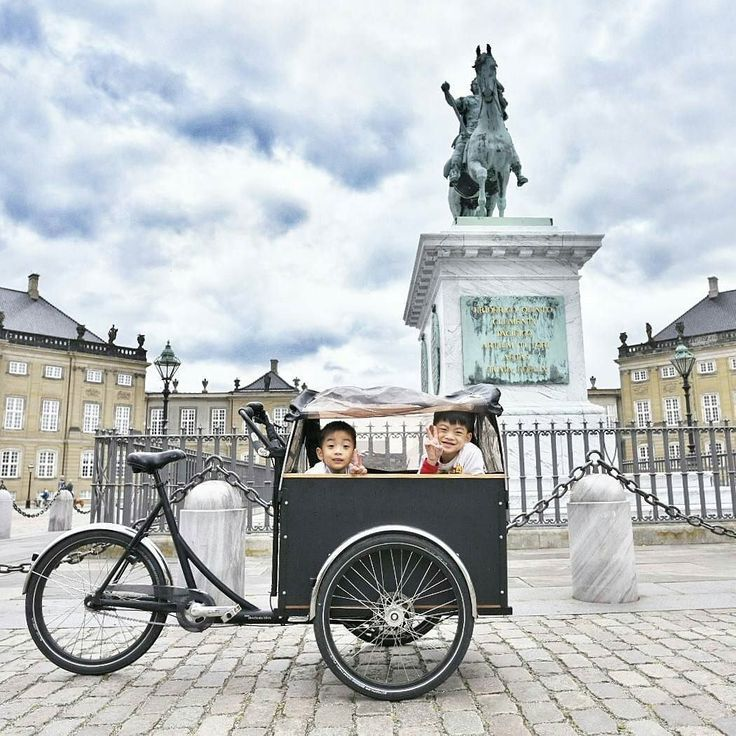"""Once they saw the Christiania bike they immediately cheered up"" #together By @bumble_bee_mum ""It was not just a novelty to them it was extremely practical! The kids could eat & sleep inside and it kept them sheltered from the cold wind and rain. So our initially crappy day in rainy Copenhagen turned into an awesome day thanks to this Christiania bike."""