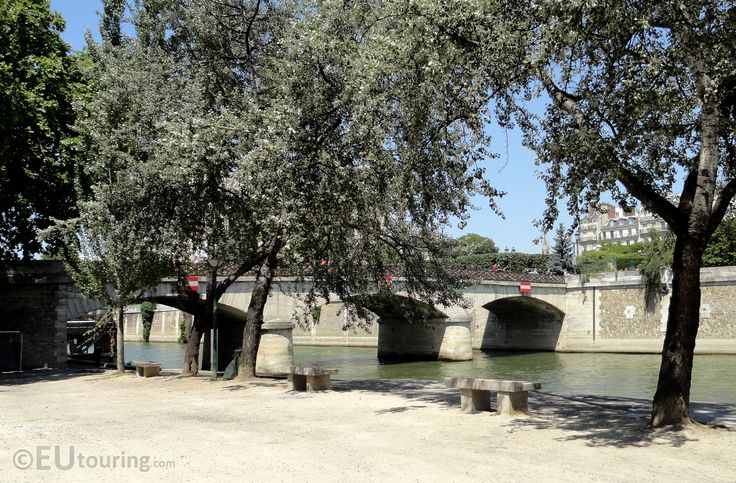 Here you can see the Quay next to the Pont de l'Archeveche, looking out towards the bridge and River Seine, with stone benches to relax on beneath the trees.  See more Paris Photos at www.eutouring.com/images_pont_de_l_archeveche.html