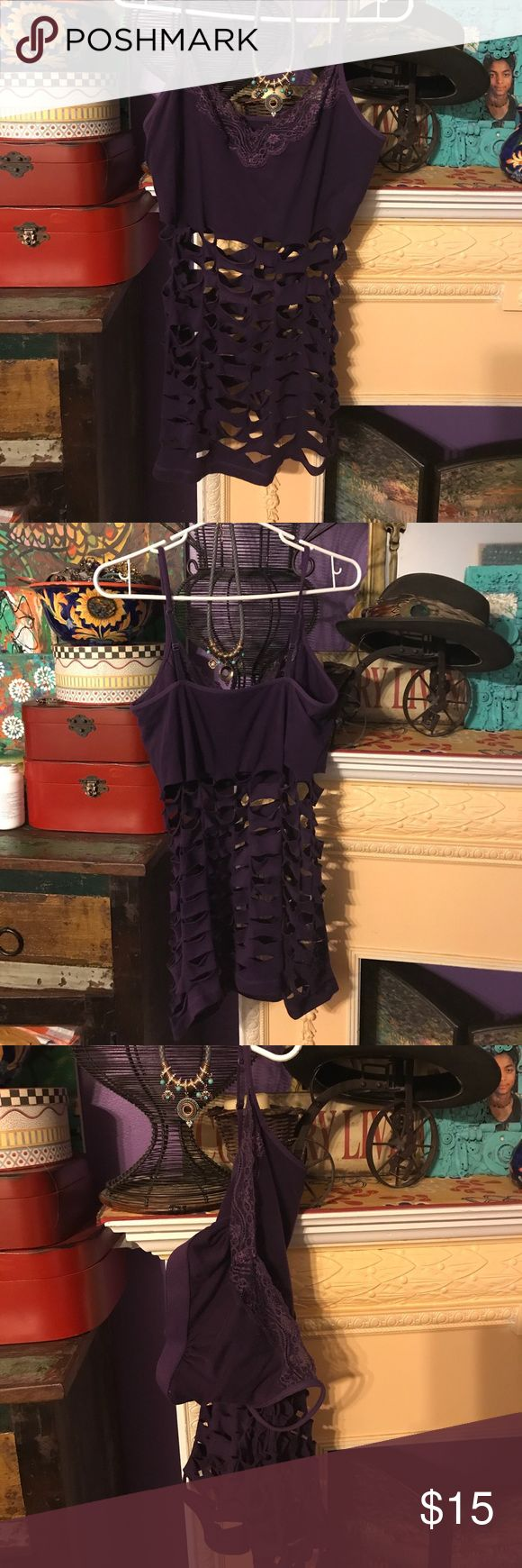Bra cami purple M with lace used pretty . Used purple cami with lace . M good condition pretty. Redesigned one of a kind can be worn with anything, now add your favorite accessory and a little imagination and you will have a different look every time you wear it Tops Tank Tops