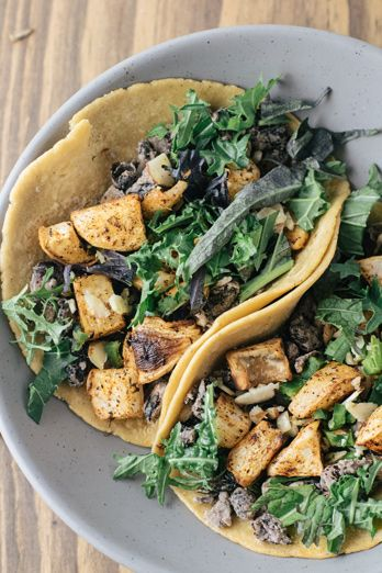 a recipe for roasted turnip tacos with lemon, dill, chili powder, orca beans, mustard greens, jalapeno and almonds.