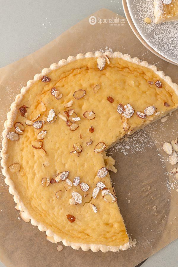 Traditional Swiss Easter Rice Tart Recipe is a crunchy sweet tart filled with a custard type filling of rice pudding, lemon, and ground almond. Spoonabilities.com