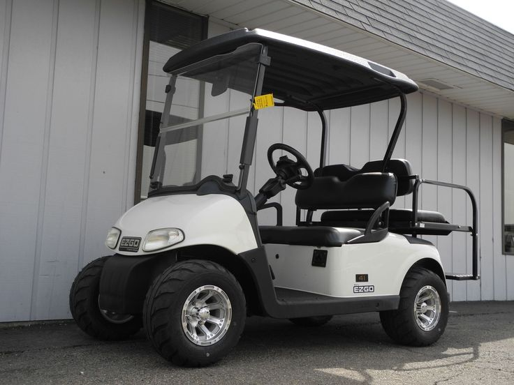 This 2010 E-Z-GO RXV electric golf car is street ready with premium lights, folding windshield, rear view mirror, black Line-X hard top, rear flip seat, digital charge gauge, new batteries, 18-inch Kenda Speedracer tires on 10-inch aluminum wheels, and more for just $4690.   #EZGO #RXV #electricgolfcar #customgolfcar #streetready #forsale #PowerEquipmentSolutions #PES #Vandalia
