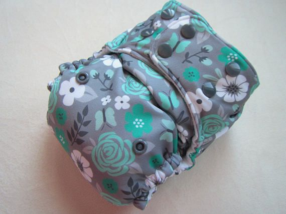 Pocket Diaper/Baby Diaper/Cloth diaper cover. This diaper features: • Fits 8lbs - 35 lbs to use from newborn to potty training! • Two Rows of snaps on front to give a perfect custom fit for all baby shapes. • Three Rise selection which means that this diaper will grow as your baby
