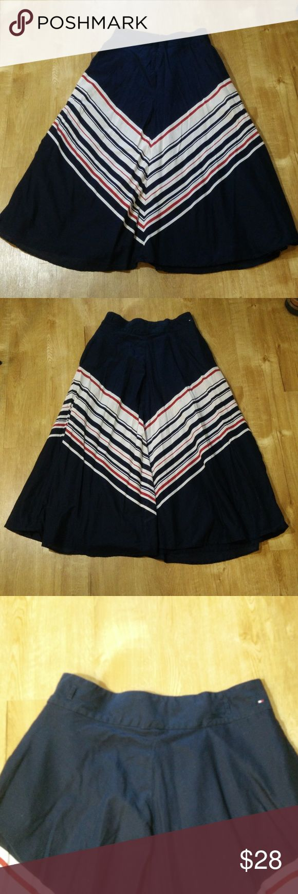 "Tommy Hilfiger Navy Cotton Striped A-Line Skirt 8 Tommy Hilfiger Womens Navy Cotton Striped Long A-Line  Cotton Lined Skirt  Size 8 - Classic looking skirt in VERY NICE overall condition with no flaws to note! (ref#2237)  Please see measurements for good fit  Measurements:  (With Pants Laying Flat – Actual Measurements are taken to the best of our ability and are approximate)     Waist  - 31""  Length  – 36"" Tommy Hilfiger Skirts A-Line or Full"