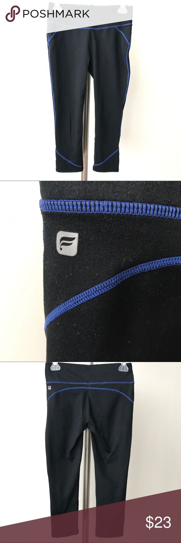 """Fabletics Lima Capri Black/Blue Stitch Size XS This is a pair of great quality Fabletics Lima Capri Black Electric Blue Stitch Size XS. There is 1 pocket in the waist.  Tag was torn.  Color: Black/Electric Blue Stitch. Fit: Maximum Compression Rise: Mid Inseam: 20""""  Fabric: Compression Knit (Made from a poly-spandex blend with all-way stretch, sweat-wicking technology and UPF 50+ protection. Brushed, cotton-like fabric with medium compression.)  Fabric Content: 88% Polyester/12% Spandex…"""