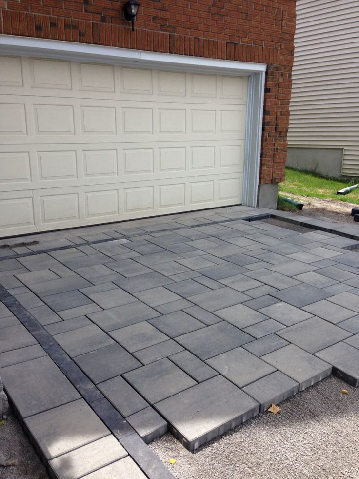 Interlock driveway in Ottawa, in the process of laying the pavers. NewFound - Land, Fence & Decks
