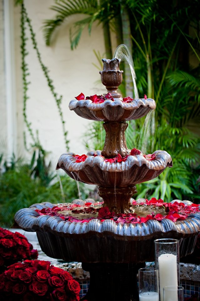 rose petals in a garden fountain, Vanessa you might like this for your wedding at the Valentine House - white roses?