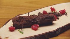 Tempered Chocolate Log with Chocolate Raspberry Ganache and Chocolate Soil. Saw this in Master Chef, when the log is cracked, a sorbet oozes out... This guy is a dessert genius!
