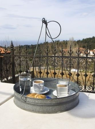 a traditional serving tray with greek coffee and cookies on a table in a veranda in North Greece Stock Photo