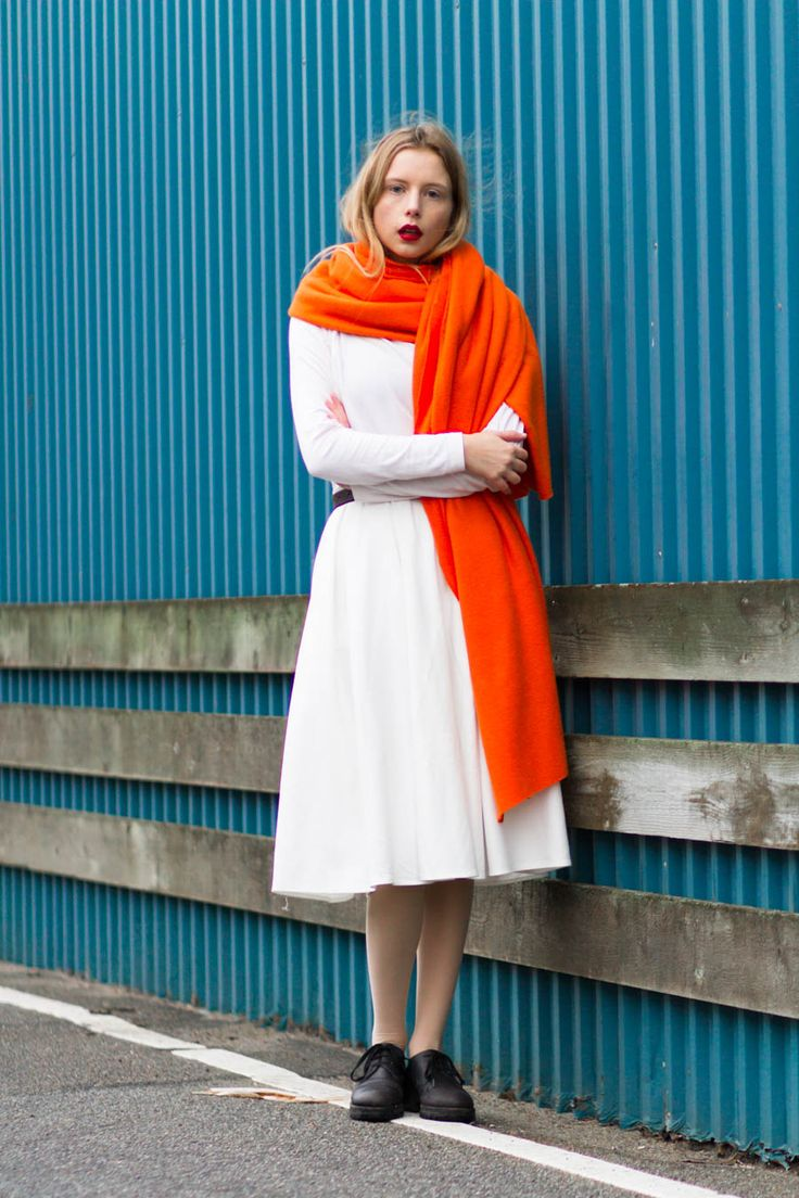 Danish blogger Marie Jensen of Nemesis, Babe blog wearing orange DIY blanket scarf, Mac Russian Red lipstick, white Føtex turtleneck sweater, asks shite skirt, marni shoes with a blue contrast background. Color blocking.  www.nemesisbabe.dk  Shop the look:  http://rstyle.me/n/tc77u8y3w http://rstyle.me/n/siek88y3w http://rstyle.me/n/s3t2k8y3w http://rstyle.me/n/tc8bg8y3w